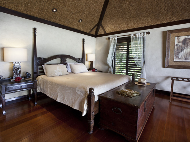 A close up view of the Ultimate Beachfront Bungalow bedroom set up featuring special gifts for check-in guests
