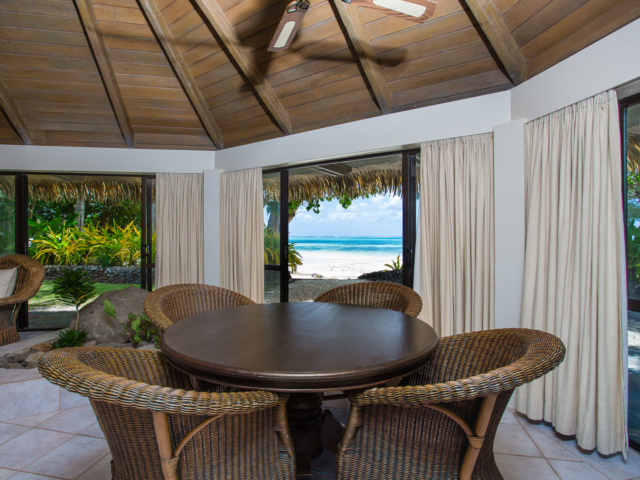 Interior image of the Premium Beachfront Villa showcasing the dinning area with a clear beachview background