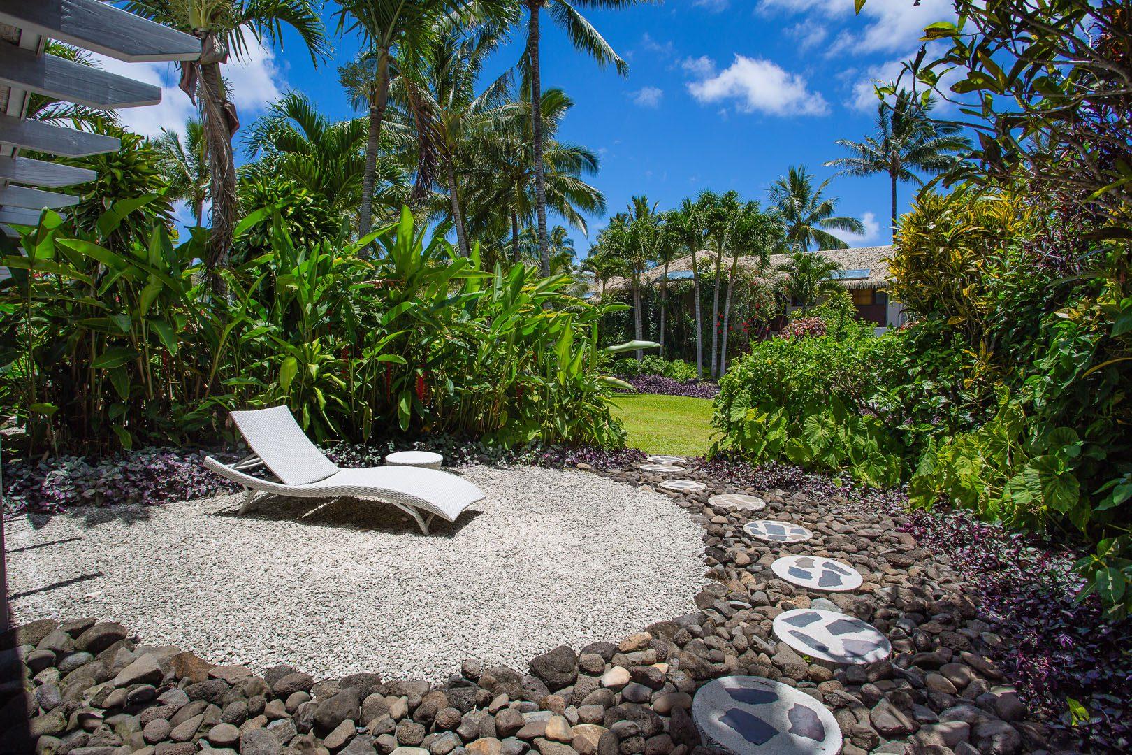 Premium Garden Villa showcasing the beautifully arranged pebble yard and the lush garden