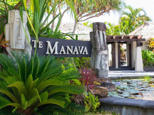 View of the te manava entrance surrounded by beautiful tropical gardens and pond