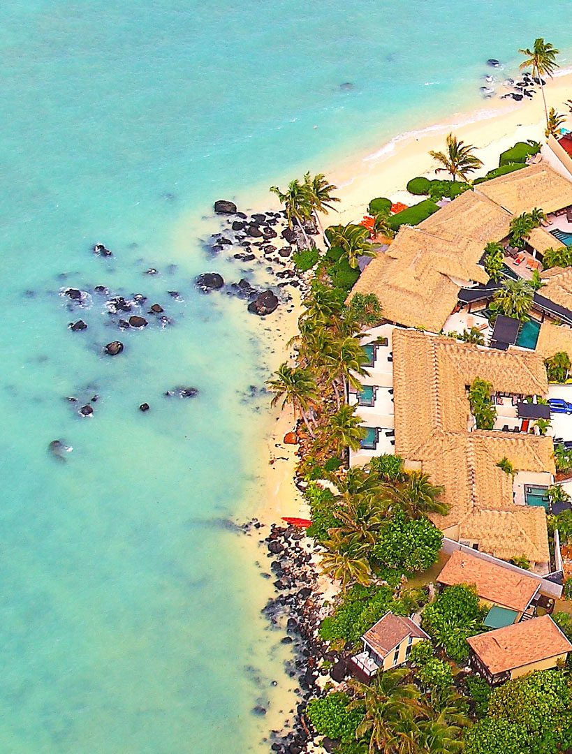 Aerial view of Te manava and it's stunning beachfront location surrounded by tropical greenery