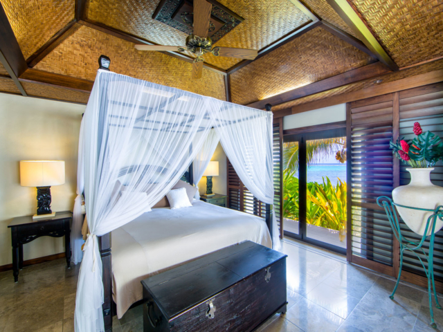 Te Manava Luxury Villas & Spa & Ultimate beachfront villa bedroom view from inside the master bedroom overlooking the water and gardens