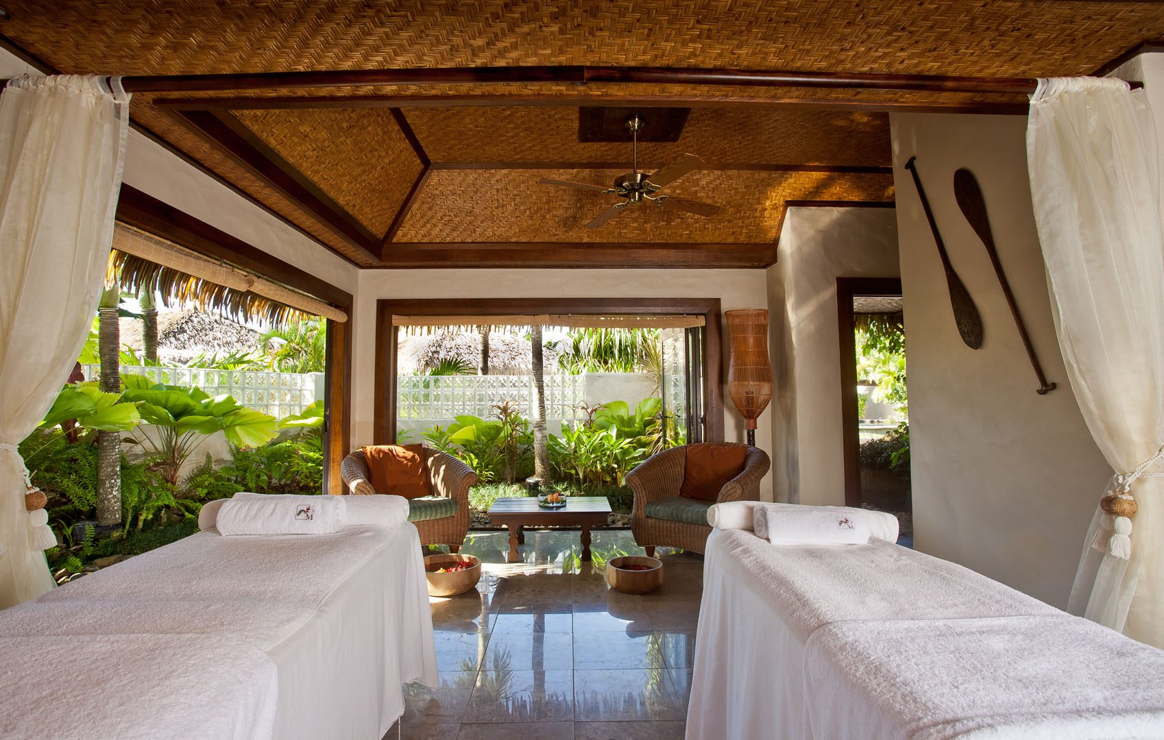 Luxurious spa with Polynesian inspired decor, looking out to the lush tropical gardens