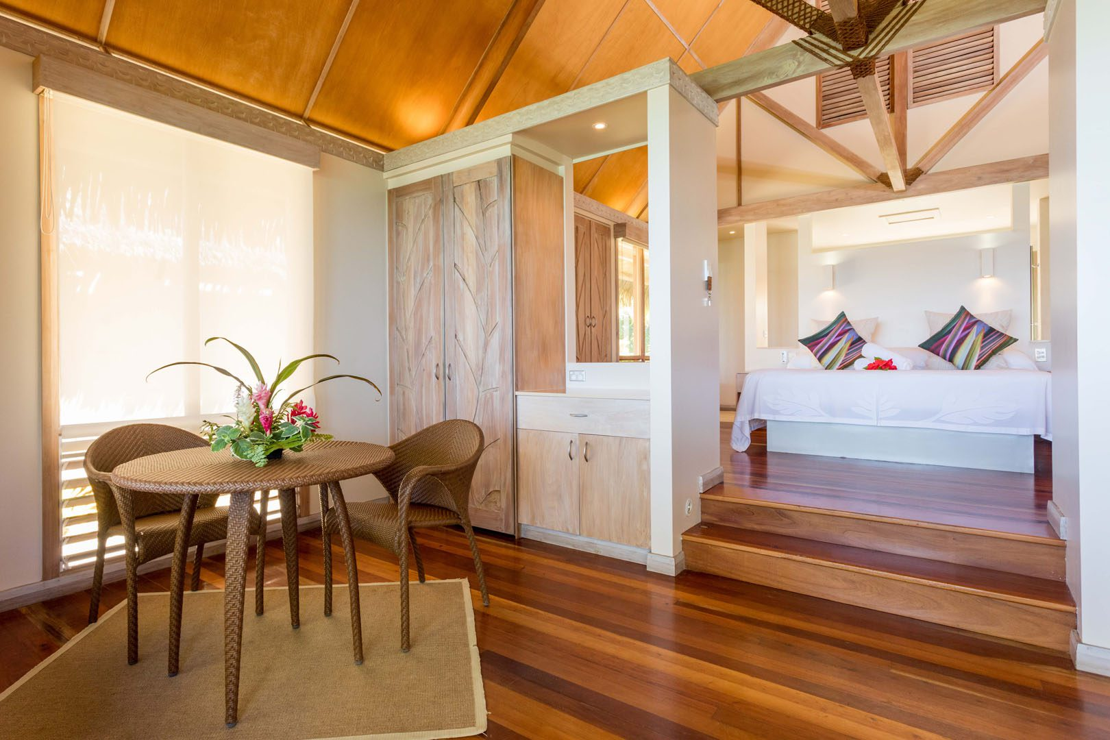 Modern & Elegant Polynesian inspired beachfront bungalow bedroom and living area