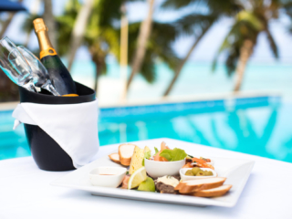 Poolside dining with an anti pesto platter and champagne